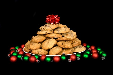 A plate of chocolate chip christmas cookies isolated on black Stock Photo
