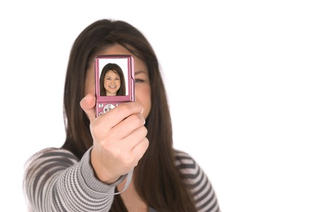 A teenager takes a self portrait with her digital camera. Stock Photo - 4364998