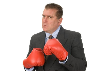 inference: A businessman ready to fight.  Isolated on white for use as any business inference.