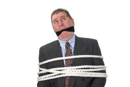 imbavagliare: Un uomo d'affari tenuto prigioniero dai suoi dipendenti. Archivio Fotografico