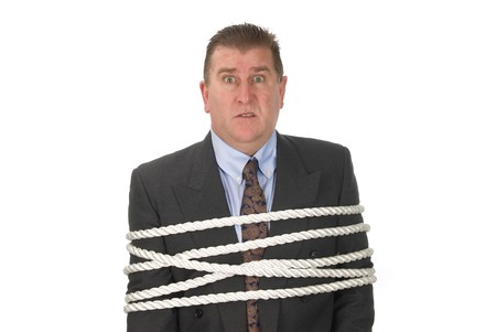A businessman is tied up by his co-workers Stock Photo - 4365029