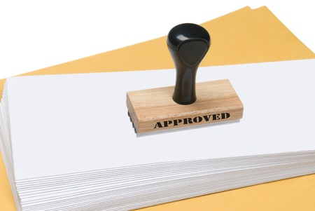 endorsement: A rubber stamp of approval ready to be used to stamp envelopes Stock Photo