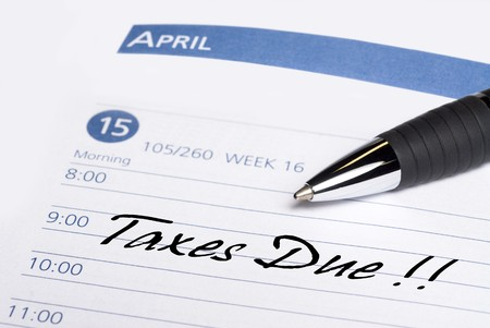 A date book communicates a reminder that taxes are due on April 15th. photo