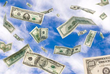 money flying: One hundred dollar bills falling from the sky.