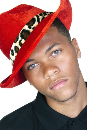 An African American model poses with a red had as if he were a pimp. Stock Photo - 4864206