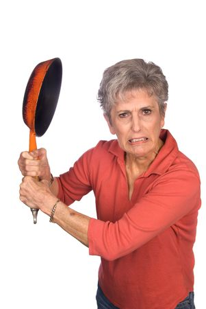 gripping hair: A mother gets ready to swing her frying pan in anger. Stock Photo