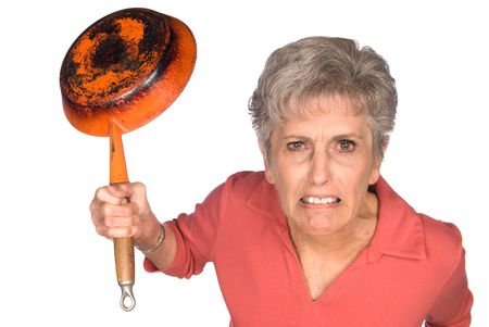 old sign: An angry woman getting ready to swing a frying pan. Image was shot on a lighted white backdrop and is not a cutout.