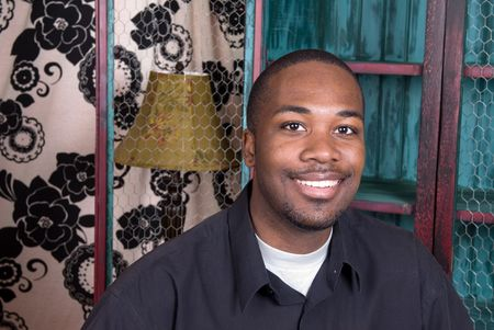 An African American smiling while resting in his living rooom. Stock Photo - 4864192