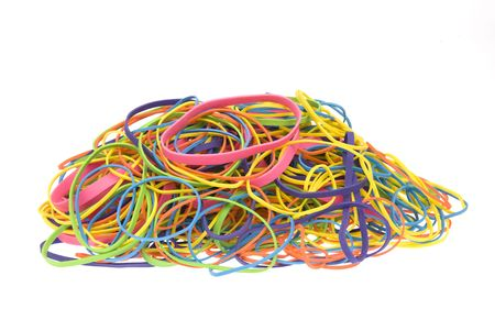 A pile of colored rubber bands isolated on a white background.
