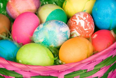 A close up of group of colored Easter eggs in a basket of grass. Stock Photo - 4869515