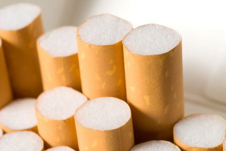 A pack of cigarettes with filters sticking up.  photo
