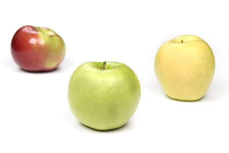 inference: Three apples show the variety of this fruit and hold a healthy eating inference.