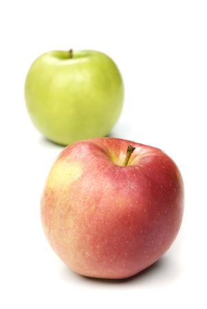granny smith apple: Two apples, a red apple and a granny smith apple ripe and ready to eat.