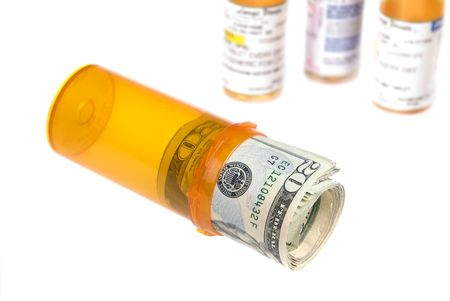 pill bottle: Rolled up cash inside of a pill bottle provides inferences on health care costs and insurance for medication.