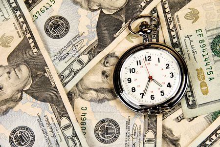 A pocket watch, or clock, timepiece on a pile of cash.  Good use for any financial inference where time is a factor of money, investment and growth. Stok Fotoğraf
