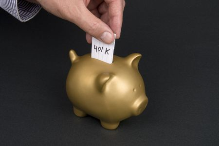 inference: A man places a slip of paper into a piggy bank inferring that he is borrowing from his 401K. Good image for a retirement financial inference.