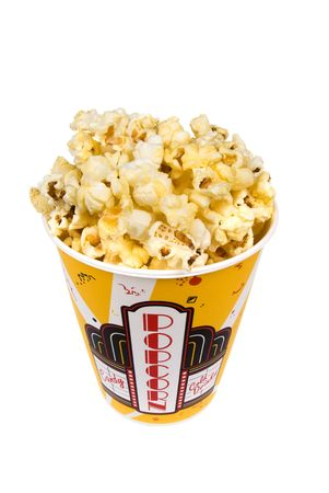 A piping hot container of movie popcorn shot with emphasis on the popcorn.  Isolated on white for the designers convenience. photo