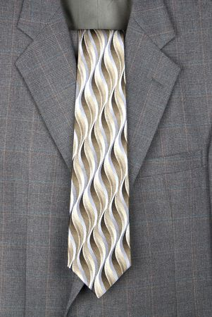 A business suit and necktie hang from a hanger. Stock Photo