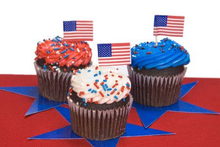 fourth july: Three red, white and blue cupcakes to celebrate Fourth of July isolated on white. Stock Photo