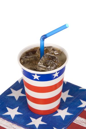 An isolated cup of ice cold soda with a blue straw symbolizes Fourth of July holiday celebration. Stock Photo - 5231691