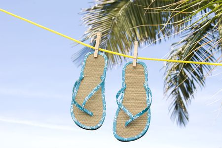 flip flops: A pair of flip flops drying in a tropical breeze on a clothesline.