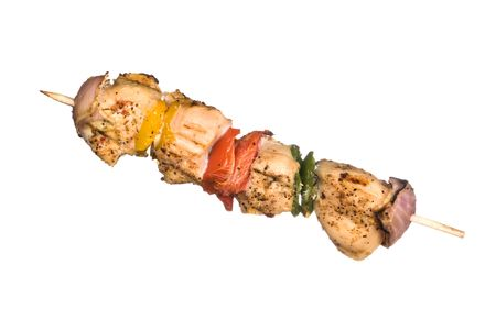 kebob: A skewered chicken kebob with grilled onions, bell peppers and delicious white meat wiith seasoning isolated on a white hbackground; Image was shot on a lighted white backdrop and is not a cutout.