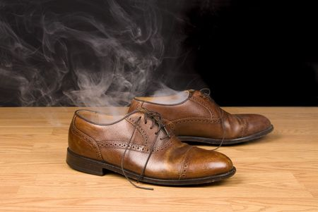 infer: A pair of dress shoes steaming after a hot day of wear and tear.  Image can also be used to infer someone has disappeared or vanashed from their shoes.