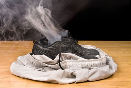 vanished: Smoking shoes and shorts insinuate that a person has vanashed right out of their clothing. Stock Photo