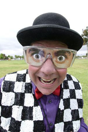 fake smile: A magician entertainer with fake eyeglasses smiles into the camera. Stock Photo
