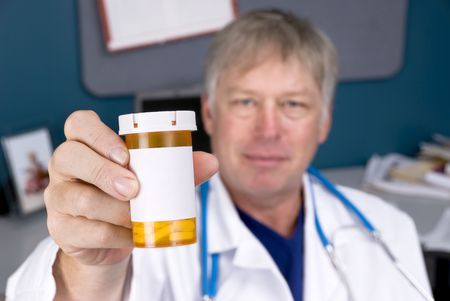 inferences: A doctor holds out a pill bottle used for prescriptions.  Label is blank for copy.  Good for pharmacy or pharmeutical inferences. Stock Photo