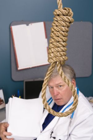 A doctor peers through a noose as he fights the bureaucracy of red tape and paperwork, rules, regulations and reform.  Paper left blank for copy. Stock Photo - 5529874