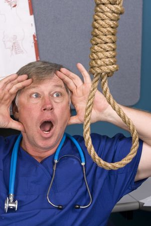 A doctor acts in shock as he discovers a noose hanging in his office. Stock Photo - 5529887
