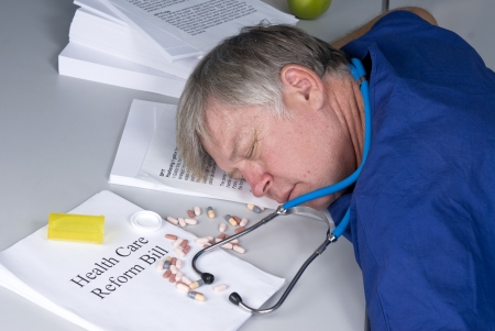 bureaucracy: A doctor is slumped over his desk after overdosing once he read the healthcare reform bill.  Designers cam clone out the healthcare text and place their own copy there.