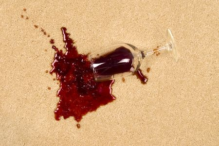 carpet stain: A glass of spilled wine on brand new carpet will leave a stain.