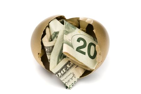 A hatched golden egg reveals some cash for retirement. Stock Photo - 5885412