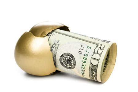A hatched golden egg reveals some cash for retirement. Stock Photo - 5885422