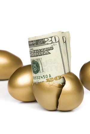 hatched: A hatched golden egg reveals some cash for retirement. Stock Photo