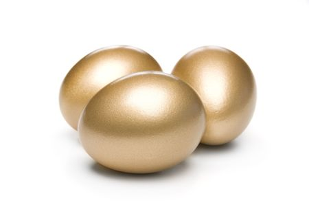 Three golden investment eggs on a white background wait to hatch