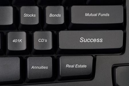 Computer keyboard keys with investment options provide guidance to success. Banco de Imagens