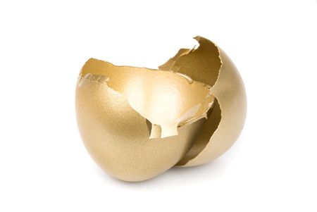 retirement nest egg: A broken, empty golden eggshell on a white background with missing financial reward inside.