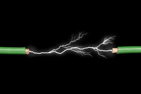 high voltage: Two wires with electrical arc powering through.