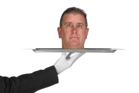 A head is served on a platter by a waiter. Image was shot for use as any trouble inference such as business and crime.