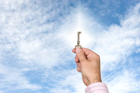 keys to heaven: A key held against the sky offers conceptual imagry of success. Stock Photo