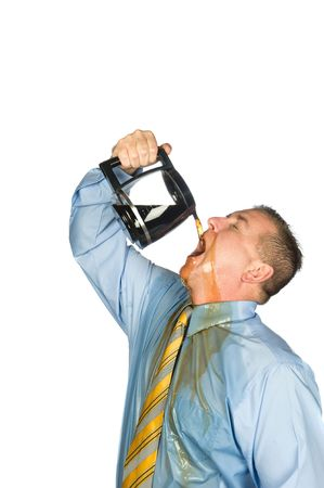 A desperate businessman drinks a pot of hot coffee to wake up because he is addicted to caffeine. photo