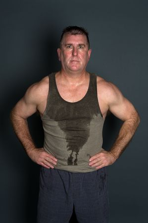 sweaty: A man is all sweaty after a hard workout.