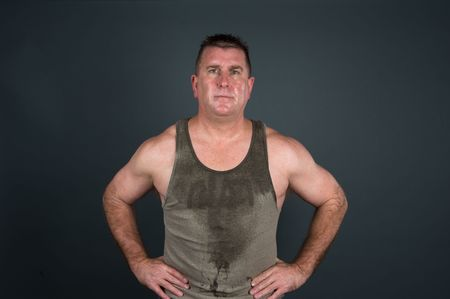 regime: A muscular man poses after a hot, sweaty workout and exercise regime. Stock Photo