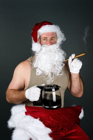 wife beater: Santa Claus relaxes with his santa top off and by smoking a fat cigar and drinking a pot of hot coffee after a long night of delivering presents. Stock Photo