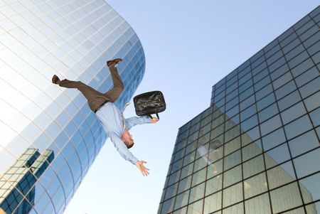 A businessman falls from a building rooftop after too much emotional stress at work caused him to commit suicide. Stock Photo - 6450569
