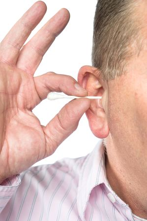 A man cleans his ear with a cotton swab for good hyegiene. photo