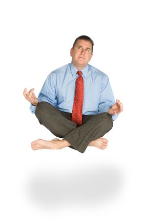 A man meditates and floats effortlessly while pondering life. photo